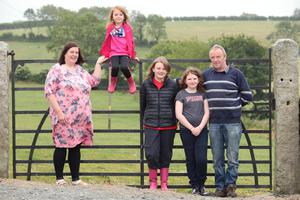 Christy Comerford with his wife Marguerite and daughters Christine (5), Collette (11) and Cynthia (10) on their farm