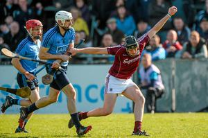 Joseph Cooney, Galway, in action against Peter Kelly, Dublin