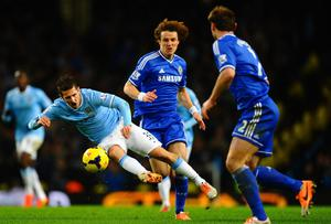 Steven Jovetic of Manchester City is put under pressure by David Luiz of Chelsea