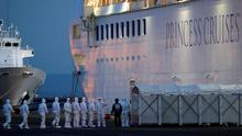 Officers in protective gear enter the cruise ship Diamond Princess, where 10 more people tested positive for coronavirus in Yokohama, Japan. Photo: REUTERS/Kim Kyung-Hoon