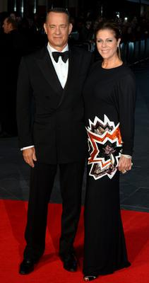 US actor Tom Hanks (L) and wife Rita Wilson attend the UK premier of 'Captain Phillips' in 2013