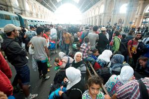 Migrants  wait inside the Keleti Railway Station in Budapest, Hungary, Thursday, Sept. 3, 2015. Migrants are now allowed to enter the station but direct trains from Budapest to Western Europe are currently out of operation until further notice. (Zoltan Balogh/MTI via AP)