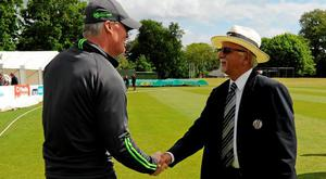 Ireland head coach John Bracewell, left, shakes hands with match referee Dev Govindjee following his team's victory over United Arab Emirates
