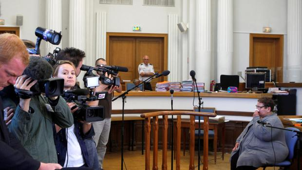 Dominique Cottrez, 51, right, appears in the courtroom of Douai, northern France,  accused of multiple counts of first-degree murder of minors, Thursday, June 25, 2015. Cottrez is on trial accused of suffocating eight of her newborns, after she told investigators that she had feared they were children of a long, incestuous relationship with her father. The worst infanticide case in modern French history stunned the country when the babies were discovered in the family garden in 2010.(AP Photo/Michel Spingler)