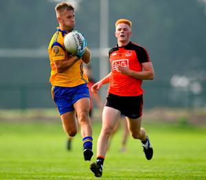 Na Fianna's Jonny Cooper gets away from Ballinteer's Eoghan Fitzpatrick in the Group 2 Round 3 match at Balgriffin
