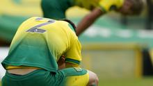 Norwich City's Max Aarons appears dejected after the final whistle as histeam's relegation from the Premier League was confirmed at Carrow Road. Photo credit: Tim Keeton/NMC Pool/PA Wire.