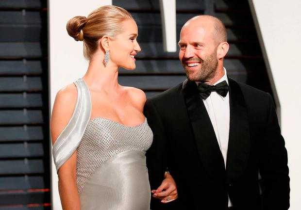Jason Statham and model Rosie Huntington-Whiteley at the Oscars Vanity Fair Party 2017. Picture: REUTERS/Danny Moloshok