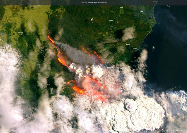 A satellite image of the Batemans Bay shows smoke and fire.