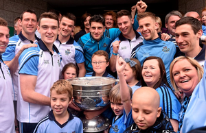 Dublin players from left, Jack McCaffrey, Denis Bastick, Brian Fenton, Eric Lowndes, Bernard Brogan, Philip McMahon, Johnny Cooper and Nicky Devereux during a visit from the GAA Football All-Ireland Champions Dublin to Our Lady's Children's Hospital, Crumlin, Dublin. Picture credit: David Maher / SPORTSFILE