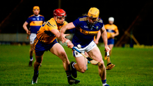 Padraic Maher of Tipperary in action against John Conlon of Clare