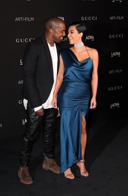 Recording artist Kanye West (L) and Kim Kardashian West attend the 2014 LACMA Art + Film Gala honoring Barbara Kruger and Quentin Tarantino presented by Gucci at LACMA