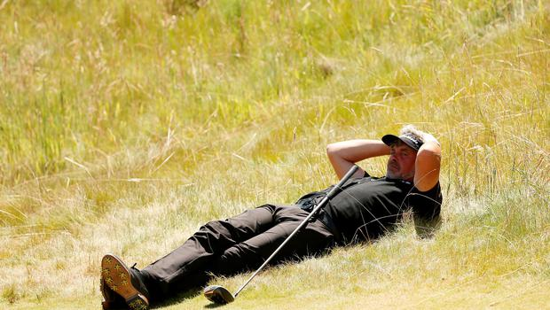 Darren Clarke takes a breather during a disastrous second round 80 at Chambers Bay