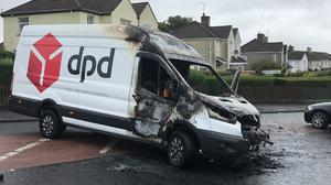 A torched hijacked van on New Road in Derry, near St Eugene's Cathedral in the city