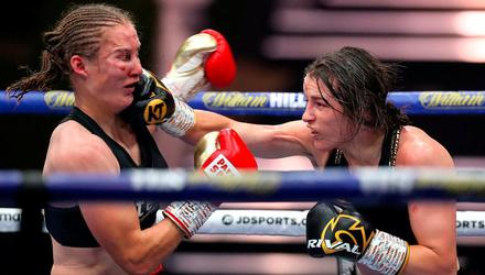Katie Taylor lands with a right hook during Saturday's undisputed lightweight title fight against Delfine Persoon in Essex. Photo: Sportsfile