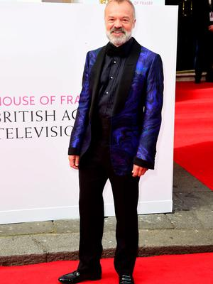 Graham Norton arrives for the House of Fraser British Academy of Television Awards at the Theatre Royal, Drury Lane in London. Photo: Ian West/PA Wire