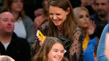 Suri Cruise (R) and Katie Holmes attend a basketball game between the Detroit Pistons and the Los Angeles Lakers at Staples Center on January 15, 2017 in Los Angeles, California.  (Photo by Noel Vasquez/Getty Images)