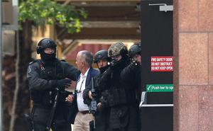 A hostage runs to safety outside the Lindt Cafe, Martin Place. (Photo by Mark Metcalfe/Getty Images)