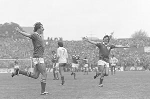 JOY: Robinson celebrates with Frank Stapleton after scoring against France in 1981. Photo: Ray McManus/SPORTSFILE