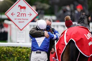 Bryony Frost gets a hug from trainer Paul Nicholls after riding Frodon to win during King George VI Chase Day of the Ladbrokes Christmas Festival at Kempton Park Racecourse.  Photo credit: Alan Crowhurst/PA Wire.