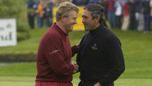 Colin Montgomerie, Great Britain and Ireland Captain, congratulates Seve Ballesteros, Continental Europe Captain, after Ballesteros parred the last hole to win his game by one hole during the Seve Trophy at Druids Glen, Co Wicklow on April 21, 2002. Photo: Matt Browne/Sportsfile