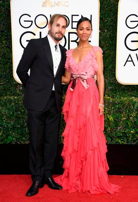Actress Zoe Saldana (R) and Marco Perego attend the 74th Annual Golden Globe Awards at The Beverly Hilton Hotel on January 8, 2017 in Beverly Hills, California.  (Photo by Frazer Harrison/Getty Images)