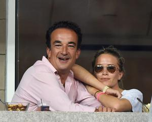 Olivier Sarkozy and Mary Kate Olsen attend day 8 of the 2014 US Open at USTA Billie Jean King National Tennis Center on September 1, 2014 in New York City. (Photo by Uri Schanker/GC Images)