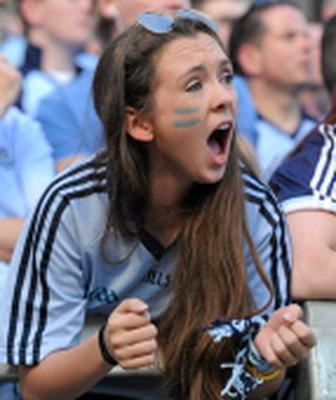 22 September 2013; Dublin supporter Ciara McComish, from Clontarf, cheers on her team during the GAA Football All-Ireland Championship Finals, Croke Park, Dublin. Picture credit: Barry Cregg / SPORTSFILE
