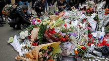 Floral tributes outside 'Charlie Hebdo' yesterday. Photo: Rossignol