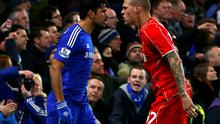 Chelsea striker Diego Costa and Liverpool's Martin Skrtel square up to one another during their Capital One Cup semi-final clash at Stamford Bridge. Photo: REUTERS/Eddie Keogh