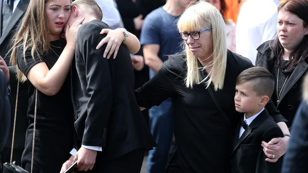 Grieving family members of Keith Walker are consoled at his funeral in Clondalkin yesterday. Photo: Collins