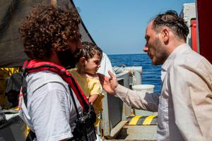 Mohamed (R) from Palestine rescued his one-year-old daughter Azeel when the boat he and his family were in with  other migrants capsized in the Mediterranean 05 August.  Mohamed's daughter was already under water but he says he managed to reach out for her and pull her to safety. His wife Diana also survived the sinking but remains in a state of shock. They are now safely aboard the Dignity I MSF search and rescue vessel which is on the scene assisting with the rescue operation.  (Photo: Marta Soszynska/MSF)