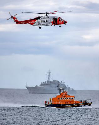 RESCUE: An Irish Coast Guard helicopter hovers over a lifeboat with the LE Roisin in the background. Photo: Marc O'Sullivan