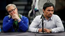 Trainer Freddie Roach, left, listens as Manny Pacquiao answers reporter questions during a press conference following his welterweight title fight on Saturday, May 2, 2015 in Las Vegas. Floyd Mayweather defeated Pacquiao in a unanimous decision. (AP Photo/John Locher)