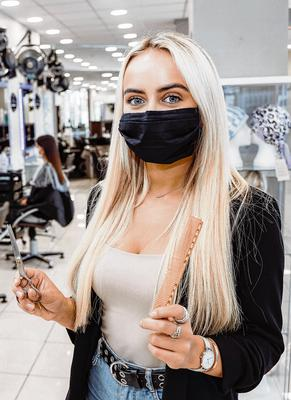 New protocols: Staff member Eva O'Brien at the Bellissimo salon in Limerick city getting ready for Monday's reopening. Photo: Don Moloney