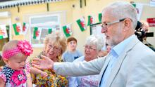 Big heart - or big ego?: UK Labour leader Jeremy Corbyn visits a children's lunch club in Swansea, Wales yesterday. Photo: Jacob King/PA Wire