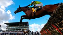 Burning Victory (far side) ridden by Paul Townend coming home to win the JCB Triumph Hurdle during day four of the Cheltenham Festival at Cheltenham Racecourse.
