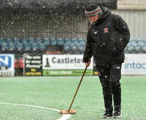 Groundsman Harry Taaffe tends to the Oriel Park pitch in the snow in February, 2018. Photo: Sportsfile