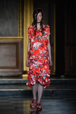 A model presents a creation from the Simone Rocha collection during the 2015 Spring / Summer London Fashion Week