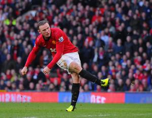 MANCHESTER, ENGLAND - MARCH 02: Wayne Rooney of Manchester United scores to make it 4-0 during the Barclays Premier League match between Manchester United and Norwich City at Old Trafford on March 2, 2013 in Manchester, England.  (Photo by Michael Regan/Getty Images)