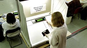 Flashback: A vote is cast on the electronic voting machine in St Cronins School, Swords, in 2002. Photo: Tony Gavin