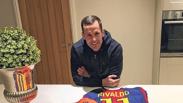 Michael Doyle at home with his collection of Barcelona jerseys