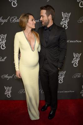 Here, she wears a Gucci gown with husband Ryan Reynolds (also in Gucci).