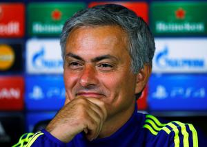 Chelsea's manager Jose Mourinho smiles during a news conference in Cobham ahead of tonight's game