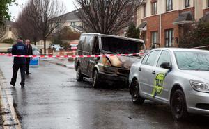 The burned out van which Gardai suspect was used by the gunmen in the Regency Hotel shooyting this afternoonthis afternoon.  Photo: Colin Keegan