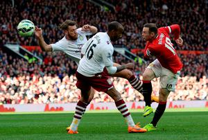 Manchester United's Wayne Rooney scores their second goal against Aston Villa