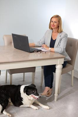 Happy place: Amy Lynch working from home with dog Bella. PHOTO: MARK CONDREN