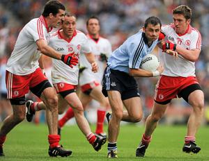 31 July 2010; Alan Brogan, Dublin, in action against Justin McMahon, left, and Dermot Carlin, 17, Tyrone. GAA Football All-Ireland Senior Championship Quarter-Final, Tyrone v Dublin, Croke Park, Dublin. Picture credit: Ray McManus / SPORTSFILE