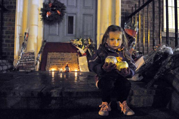 A three year old girl holds a candle at a vigil which took place outside the Dail this evening to highlight the homelessness and housing crisis after a homeless man - who was in his forties - was discovered in a doorway on Molesworth Street in Dublin at around 8 o'clock yesterday morning. Photo: Clodagh Kilcoyne