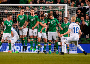 Hordur Bjorgvin Magnusson's free-kick squeezes through the Irish wall for what proved to be the winning goal. Photo: Sportsfile