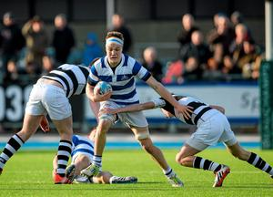 Ted Godson-Treacy, Blackrock College, is tackled by Johnny Bell, left, and Ted Walsh, Belvedere College